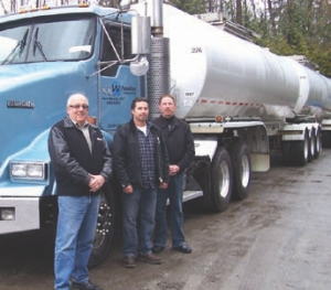SAFETY FIRST: (L-R) Grant Allen, general manager; Tony Spring, vice-president; and Darrell Spring, president, have taken a safety-first approach to running Wheeler Transport.