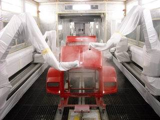 High-tech robots paint a Kenworth truck cab at the Chillicothe plant.
