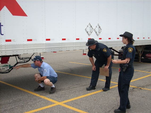 A driver completes an inspection under the watchful eyes of inspectors during the Toronto Regional Truck Driving Championships.