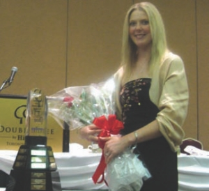 TOPS IN SHOP: Ben Vandespyker's daughter Lisa accepts the Maintenance Manager of the Year trophy on his behalf at CFMS.