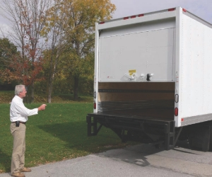 EASY TO USE: The roll-up door on this straight truck is opened with the click of a button, using the handheld keychain-type remote control.