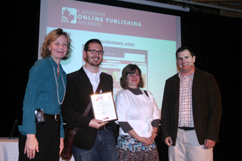 Trucknews.com editors receive the Best Video prize at the Canadian Online Publishing Awards. Starting second from left: Adam Ledlow, Julia Kuzeljevich, and James Menzies.