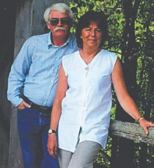 FOND MEMORIES: Wendy Foulis and her husband Ron share a moment in better times, before his health deteriorated while far from home.