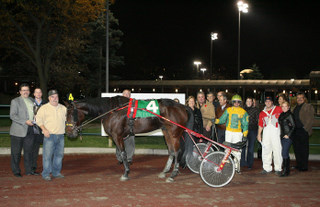 Kevin Burch (far left) presented the winning trophy to the owner of Caviar's Dream following the first ever Truckload Carriers Association Race held at Woodbine.