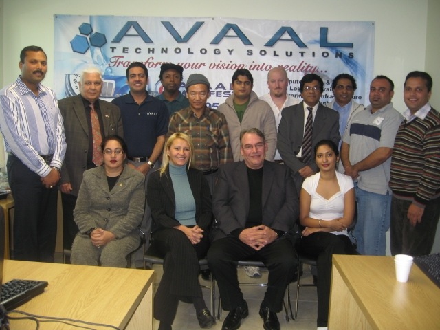 Graduates from Avaal's Dispatch Specialist Course pose with speakers and special guests at the company's 43rd graduation ceremony Nov. 8.