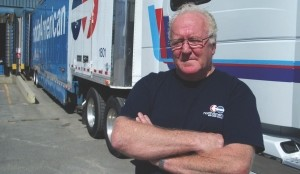 CHANGING GEARS: Bill Waistell pauses for reflection as his trailer is loaded with furniture one last time. After 40 years in the furniture hauling business, Waistell's ready to spend more time fishing and golfing.