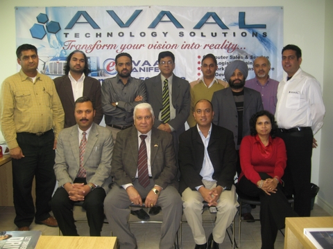 Avaal's latest group of grads poses with special guests after the ceremony in Brampton Dec. 6.