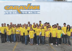 TEAM EFFORT: Caravan Logistics not only provided the equipment to haul donated food items during a recent food drive, it also provided the people to help get the job done.