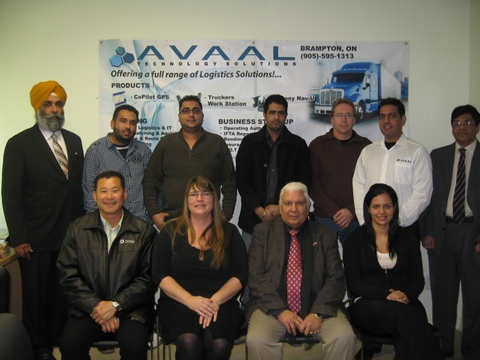 Avaal's latest group of grads poses with special guests after the ceremony in Brampton Jan. 10.