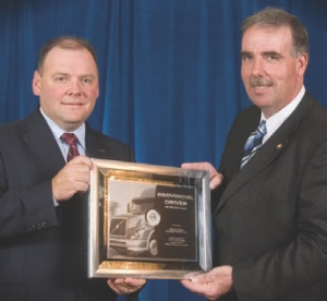 CONGRATS: Jim Coles (right) was named Ontario's Driver of the Year. The MacKinnon driver is seen here accepting his award from Volvo Trucks Canada's Peter Currie.