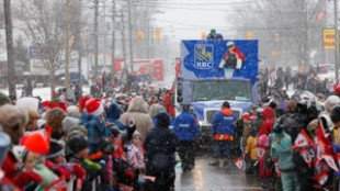 Canadians from coast-to-coast gathered to see the Olympic Torch Relay pass through their towns.