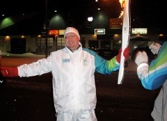 Jim Miller drove one of the trucks along the relay and was surprised with his own chance to carry the torch.