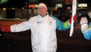 ALL SMILES: Jim Miller drove an RBC-sponsored truck along the torch relay, and received an unexpected thanks -the chance to carry the torch in northern Quebec.