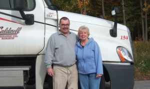 CALL OF THE OPEN ROAD: Joe Amelia and his wife Mary Beth have found happiness in a trucking career, after giving up their office jobs.