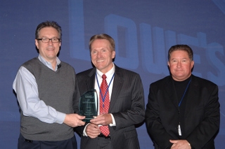 Steve Palmer, vice-president, transportation, Lowe's Companies presents the Platinum Service Award to Rob O'Reilly, president, TST Overland Express (centre) and Reg Peters, vice-president, corporate accounts, TST Overland Express (right).