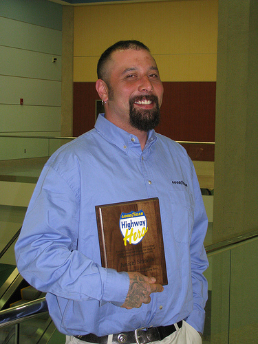 Junichi Shimizu poses with his award plaque shortly after winning the Goodyear North America Highway Hero title. Shimizu saved the lives of three people involved in a firey traffic accident in February 2009 to earn the award.