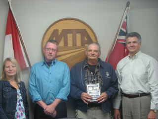Susan Snyder, MTA President; Steve Simmons, Arnold Bros Transport Ltd; Bill Gagnon, Big Freight Systems Inc; Jim Clark, Customs Truck Sales Inc. (not pictured: Ken Bradley, Arnold Bros Transport Ltd).