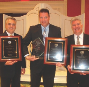 CANADIAN TRIO: Safety reps (l-r): Garth Pitzel (Bison); Tom Boehler (Erb); and Jeff Lehmann (MacKinnon) celebrate their hard-earned awards.