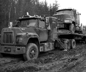 GOING NOWHERE: Trucks that were on Manitoba's winter roads when a sudden thaw struck were bogged down in mud and unable to continue. In at least one case, the driver had to be airlifted out by RCMP.