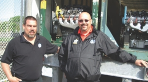 SPECIAL DELIVERY: Warehouse manager Lance Lund (left) and APPS driver and OTA Road Knight Guy Broderick prepare to unload some new GM engines at Central Technical Institute in Toronto.