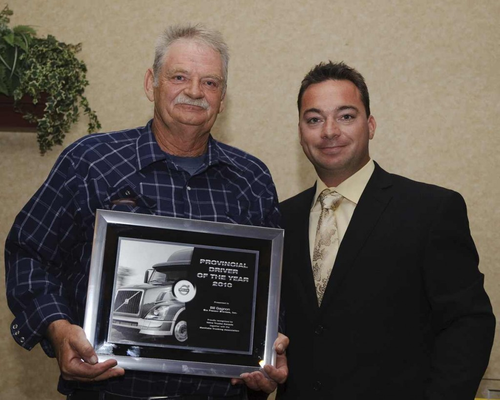 Bill Gagnon (left) was named Manitoba Driver of the Year. He receives his award from Kevin Schers.