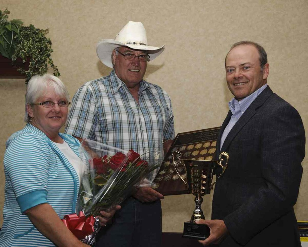 Howard McAfee, pictured with wife Theresa and Allan Smeall, won Manitoba's Grand Champion award.