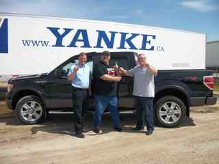 Pictured, from left to right is Bill Kalbhenn (director of fleet safety and recruiting), Brian Huggy Halabura (award-winning Yanke operator) and Craig Bailey (v.p. of YMS, YGLS, YSCS).