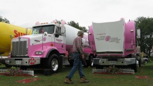 An observer checks out the Superior Propane trucks, which wont the Best Displayed Fleet category.