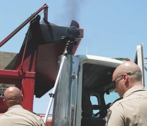 Ready, set, blow!: Enforcement officers in Quebec can measure truck emissions on the spot, using recently-acquired tools. Photo by Carroll McCormick