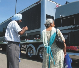 Picture time: Visitors to the Road Today Truck Show in Brampton take a few pictures at the show'n'shine competition.