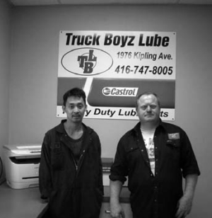 New start: Former truck driver Patrick Whiteside (right) left trucking to serve truckers, along with shop manager Eddy Victoria.