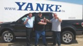 SAFETY PAYS: Pictured, from left to right is Bill Kalbhenn (director of fleet safety and recruiting), Brian 'Huggy' Halabura (award-winning Yanke operator) and Craig Bailey (v. p. of YMS, YGLS, YSCS).
