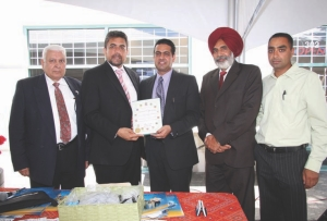 Expanding west: Avaal president and CEO Dara Nagra (centre) poses with special guests at the grand opening of the company's Surrey, B.C. office July 24. The new location is at 302-17665 66A Avenue in Surrey.