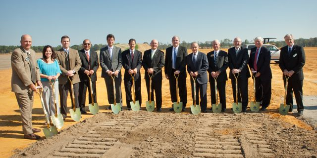 Company officials and dignitaries gather to officially break ground at the site of Great Dane's new refrigerated trailer plant, which will be producing trailers by 2012.