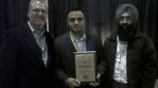 (L-R) Jeff Moore, managing director of Lakeside Logistics presents the Carrier of the Year award to Road Link Xpress's Raj Dhaliwal, co-owner and Peter Sandhu, dispatcher.