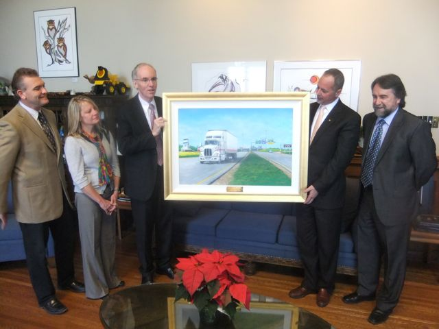 The MTA recently gave this painting to Transport Minister Steve Ashton. Pictured are (l-r): Greg Arndt, Jade Trucking; Susan Snyder, Searcy Trucking; Minister of Infrastructure and Transportation Steve Ashton; MTA president Tom Payne Jr., Payne Transportation; and artist Glenn Hayes.