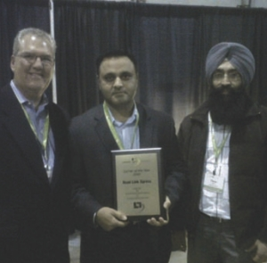 BEST OF THE BEST: Road Link Xpress won Carrier of the Year. Accepting the award from Lakeside's Jeff Moore was Raj Dhaliwal (middle) and Peter Sandhu.