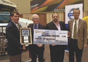 SAFETY PAYS: MacKinnon Transport was named winner of the Volvo Trucks Fleet Safety Award. Pictured are (l-r): Ron Huibers, Volvo; Evan MacKinnon and Rick Miller, MacKinnon Transport and Tim Fulton, Michelin.