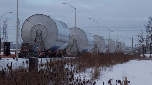 THE BIG SLEEP: The vats spent their days parked on the side of the road where they were welcome subjects for the cameras of passersby. Pictured above are the tanks resting on Trafalgar Rd., just south of Hwy 401, on the afternoon of Jan. 5.