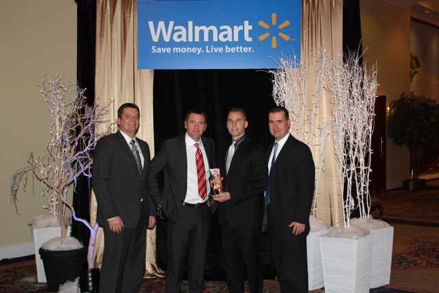 Bison Transport executives receive Innovative Carrier of the Year honours from Walmart Canada during a recent ceremony.