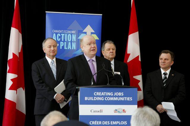 Pictured (L-R): Honourable Rob Nicholson, Tony Geoghegan, Dr. Kenneth Loucks, Lew Holloway.