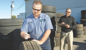 TEAMWORK: Ideally, scrap tire analysis is a two-person job. One person can read out observations while the other records the information.