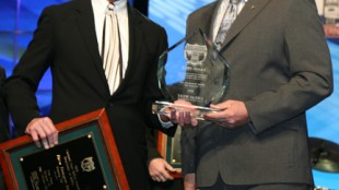 Rob Penner (right), vice-president of operations with Bison Transport, accepts the grand prize for truckload carrier companies in the large carrier division at the National Fleet Safety Awards, from Patrick Kuehl, executive vice-president of Great West Casualty Company. This year marked the fourth time that Bison has been awarded the grand prize in its division.