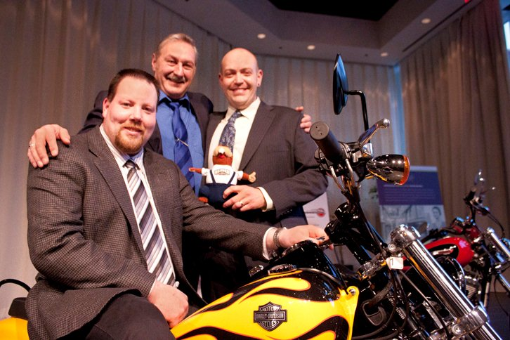 Dennis Baehnk (seated on motorcycle), Dan Teleglow (centre) and Chris Dunn will be representing Beaver Truck Centre at the Volvo Vista world championship in Sweden in June. Each team member was presented with a motorcycle for reaching the competition's finals.