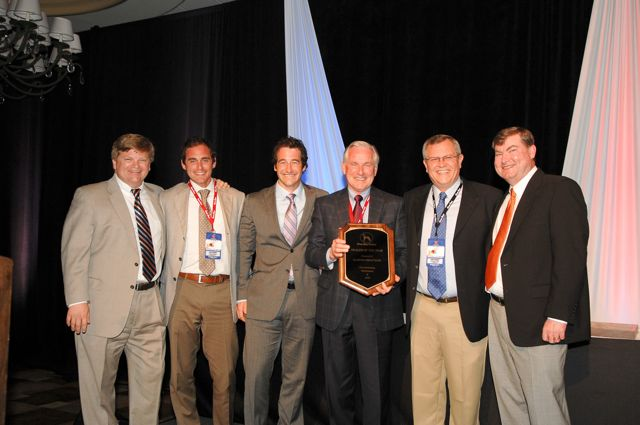 From left: Great Dane's v.p. of dealer sales, Chris Hammond, presents the Dealer of the Year Award to Glasvan Great Dane's Paul Cobham, George Cobham, Jr., and George Cobham, Sr., along with Great Dane regional sales director John Schmidt and Mike Wright, Great Dane's director of dealer sales and development.