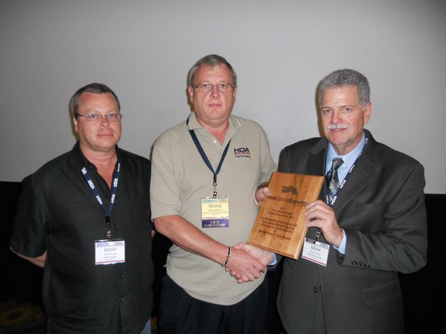 Wayne Marshall (centre) was named the Truck Service Expert of the Year during a recent ceremony.