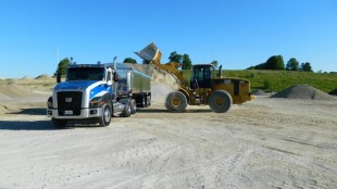 A Cat loader and a Cat CT660 truck make a good match in the pit.