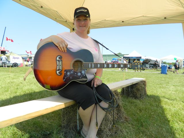 Anne Finley is pictured after performing her song Convoy for a Cure at the Stirling Truck Show. Proceeds from the sale of the song on CDBaby.ca and hopefully iTunes will be donated to the Canadian Breast Cancer Foundation.