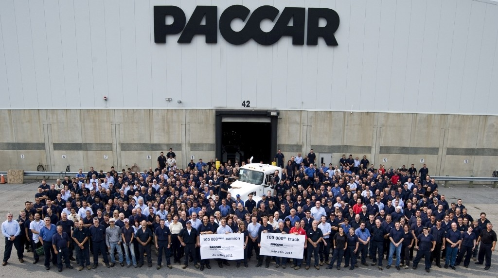 Employees at Paccar's Ste-Therese, Que. facility gather to celebrate the production of the plant's 100,000th medium-duty truck - a Kenworth T370 for Altec Industries.