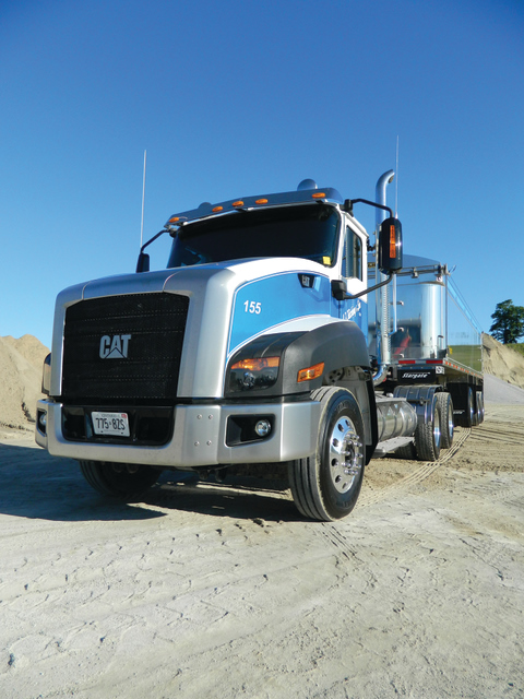 CANADA'S CAT: J.F. Kitching & Son of Queensville, Ont. has been running this Cat CT660 - the first in Canada - all summer. The only drawback, its driver says, is that productivity has been reduced because everyone wants to take a peek inside whenever the truck is stopped. Photo by James Menzies